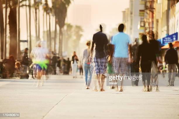 Motion blurred pedestrians on boardwalk