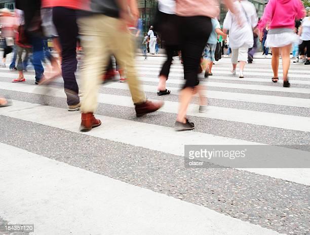 Motion blurred pedestrians on major zebra crossing