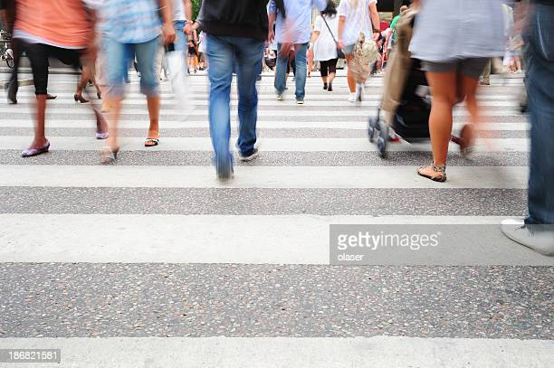 Motion blurred pedestrians on major zebra crossing