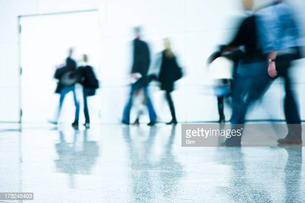 Motion Blurred People Walking Indoors