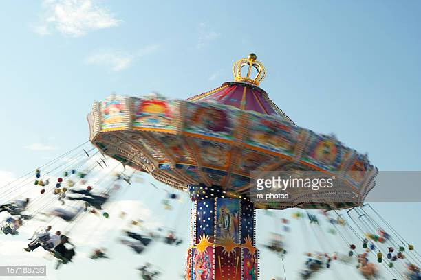 A motion blurred photo of a chairoplane