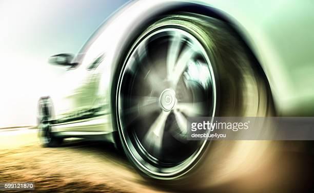 Motion blurred sports car tire