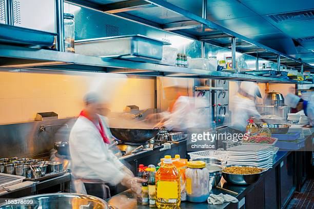 motion chefs  of a restaurant kitchen