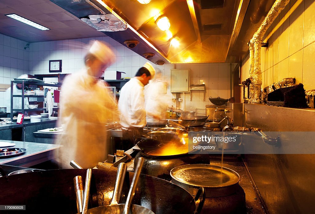 Restaurant Kitchen Chefs motion chefs of a restaurant kitchen stock photo | getty images