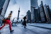 motion passengers walking on the landmark of shanghai china background.