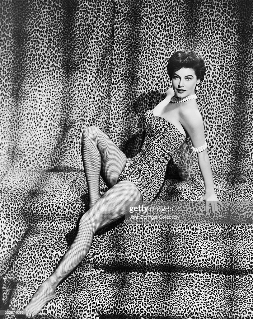 Motion picture actress <a gi-track='captionPersonalityLinkClicked' href=/galleries/search?phrase=Ava+Gardner&family=editorial&specificpeople=93109 ng-click='$event.stopPropagation()'>Ava Gardner</a> poses in a leopard skin outfit with matching backdrop.