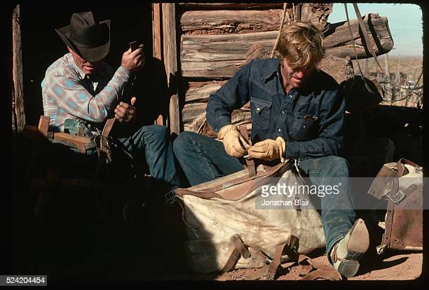 Motion picture director Robert Redford lends a hand at a rancher on Utah's Robbers Roost Trail | Location Robbers Roost Trail Utah USA