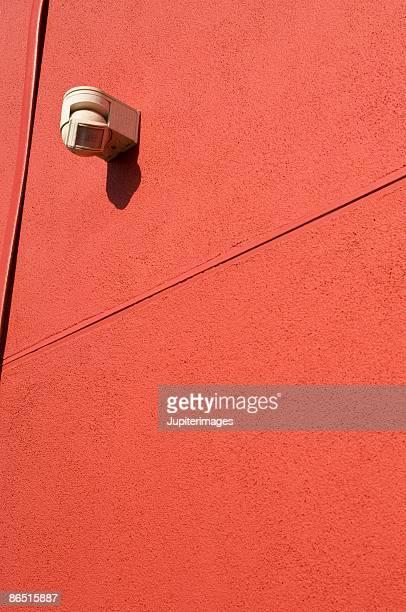 Motion sensor light on red wall