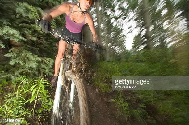 Motion shot of female mounatin biker