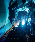The Motion Welding robots in a car factory with sparks, manufacturing, industry, factory