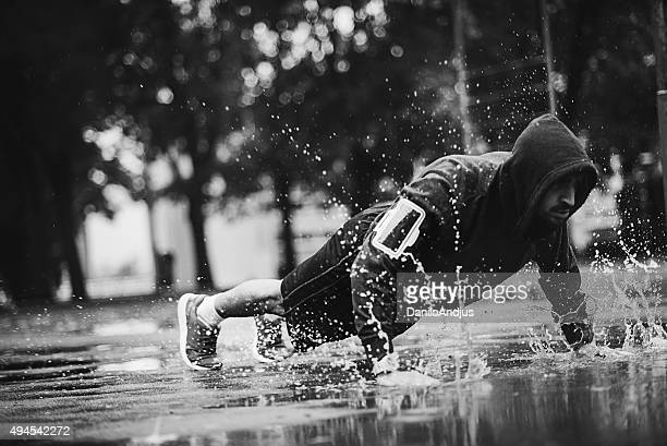 motivated man working out in the rain