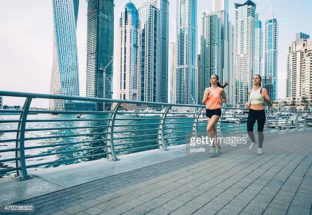 Motivated women running outdoors in Dubai Marina