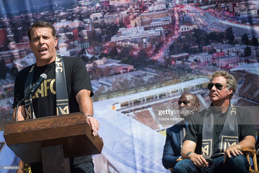 Motivational speaker Tony Robbins former NBA player Earvin 'Magic' Johnson and actor Will Ferrell attend the Los Angeles Football Club stadium...