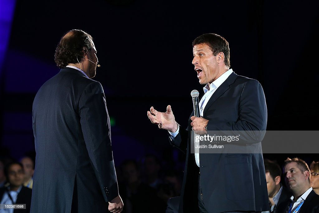 Motivational speaker Tony Robbins (R) talks with Salesforce CEO Marc Benioff as he delivers the keynote address during the Dreamforce 2012 conference at the Moscone Center on September 19, 2012 in San Francisco, California. A reported 90,000 people registered to attend the cloud computing industry conference Dreamforce 2012 that runs through September 21.