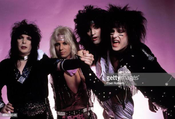 Photo of Vince NEIL and Nikki SIXX and Tommy LEE and MOTLEY CRUE and Mick MARS Posed group shot studio LR Mick Mars Vince Neil Tommy Lee Nikki Sixx