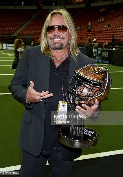Motley Crue singer and Las Vegas Outlaws owner Vince Neil displays a rivalry trophy before the team's game against the Los Angeles Kiss at the Thomas...