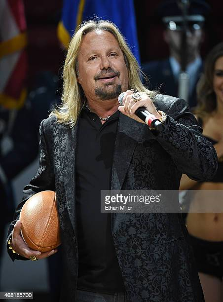 Motley Crue singer and Las Vegas Outlaws owner Vince Neil performs the American national anthem before the Outlaws' inaugural home game at the Thomas...