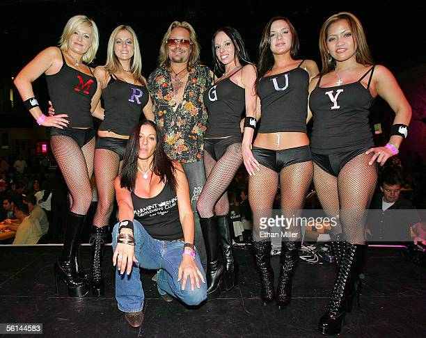 Motley Crue singer Vince Neil poses with Spearmint Rhino Gentlemen's Club dancers Stevie Foster Jordan Delilah Avianna Nyah during the inaugural...