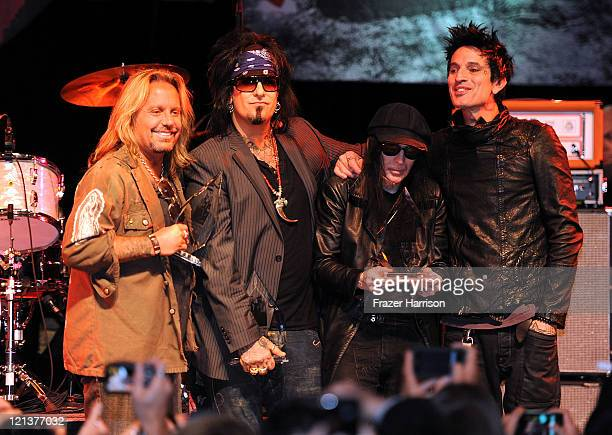 Motley Crue Vince Neil Nikki Sixx Mick Mars Tommy Lee with their awards on stage at the the Annual Sunset Strip Music Festival Tribute to Motley Crue...