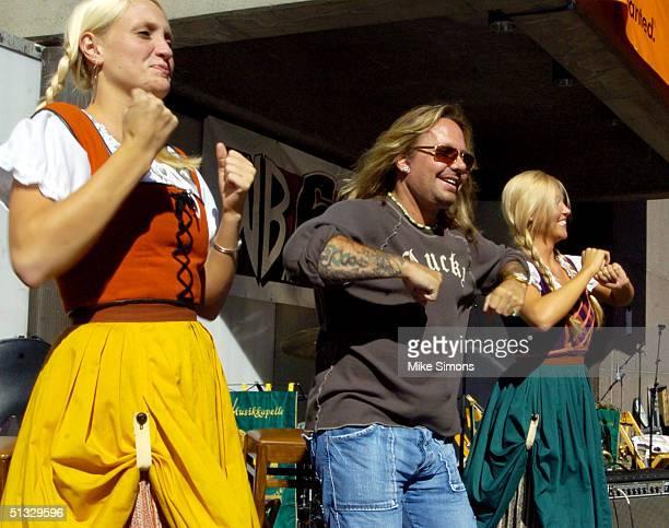 Motley Crue's Vince Neil leads the World's Largest Chicken Dance at OktoberfestZinzinnati September 19 2004 in Cincinnati Ohio