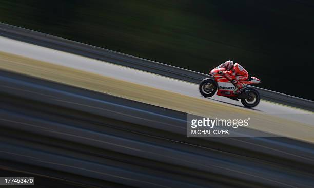 Moto GP rider Nicky Hayden of United States rides his Ducati during the second free practice session at the Czech Republic Grand Prix in Moto GP on...