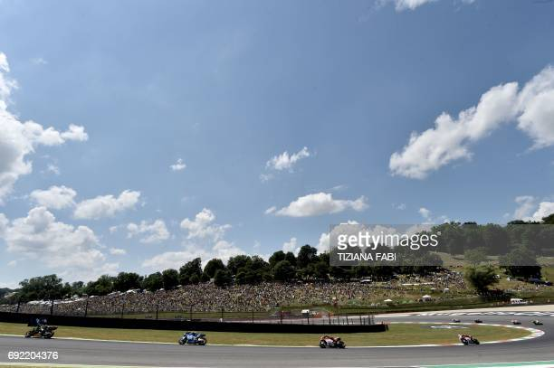 Moto GP riders compete during the Italian Grand Prix at the Mugello race track on June 4 2017 Ducati's Andrea Dovizioso thrilled the home crowds with...