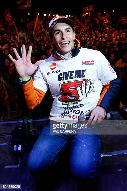 Moto GP world champion Repsol Honda Team's Spanish rider Marc Marquez poses during the celebration of his title in his home town of Cervera near...