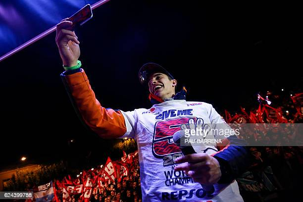 Moto GP world champion Repsol Honda Team's Spanish rider Marc Marquez takes a selfie photo during the celebration of his title in his home town of...