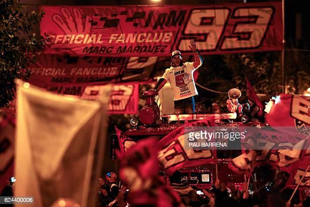 Moto GP world champion Repsol Honda Team's Spanish rider Marc Marquez celebrates his title in his home town of Cervera near Barcelona on November 19...