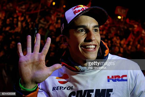 Moto GP world champion Repsol Honda Team's Spanish rider Marc Marquez poses as he celebrates his title in his home town of Cervera near Barcelona on...
