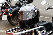 Moto helmet motorcycle and motorbikes on blurred background