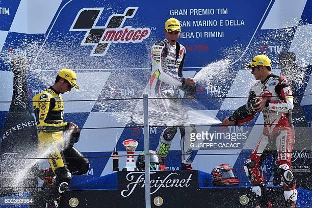 Moto2 Forward Team Italian Lorenzo Baldassarri celebrates on the podium his first position next to second position Paginas Amarillas Spanish rider...