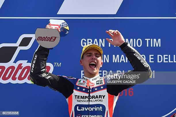 Moto2 Forward Team Italian Lorenzo Baldassarri celebrates on the podium after winning the Moto2 race of the San Marino Moto GP Grand Prix at the...