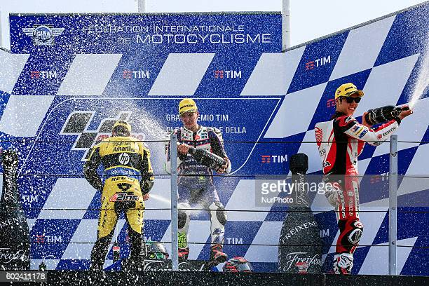 Moto2 Podium Lorenzo Baldassarri from Italy Alex Rind from Spain and Takaaki Nakagami from Japan at the end of the Race at the Marco Simoncelli World...