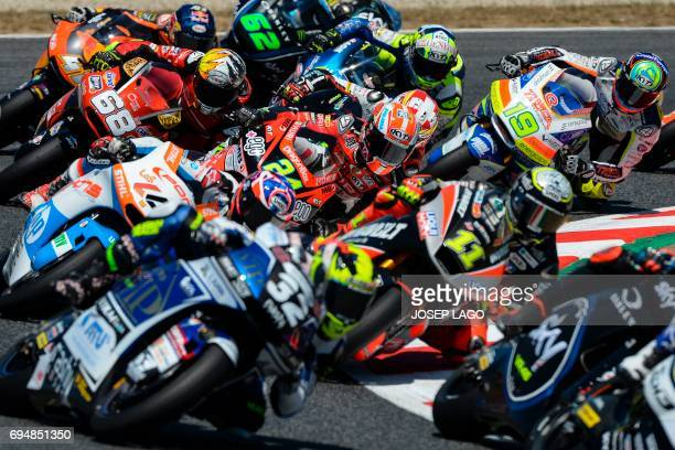 Moto2 riders race during the Moto2 event of the Catalunya Grand Prix at the Montmelo racetrack near Barcelona on June 11 2017 / AFP PHOTO / Josep LAGO
