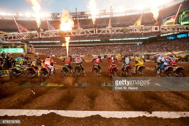 Monster Energy AMA Supercross Rear view of Team Monster Energy Kawasaki Joshua Grant Team Monster Energy Kawasaki Eli Tomac Team RMATVMC Blake...