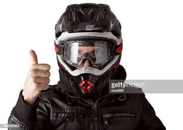 Motorrad-Motocross-Fahrer mit Enduro Helm Daumen hoch