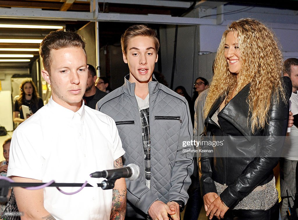 Motocross rider Lance Coury, actor Austin North and tennis player Victoria Azarenka attend Cartoon Network's fourth annual Hall of Game Awards at Barker Hangar on February 15, 2014 in Santa Monica, California.