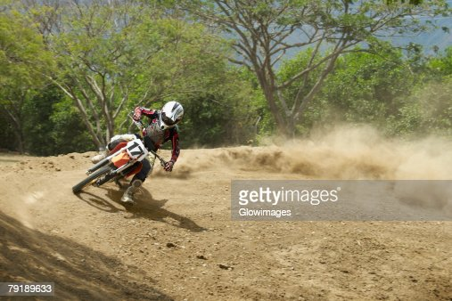 Motocross rider leaning into a turn : Foto de stock