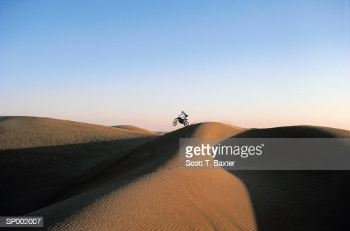 Motocross Rider on Dunes