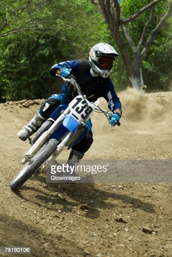 Motocross rider riding a motorcycle : Stock Photo
