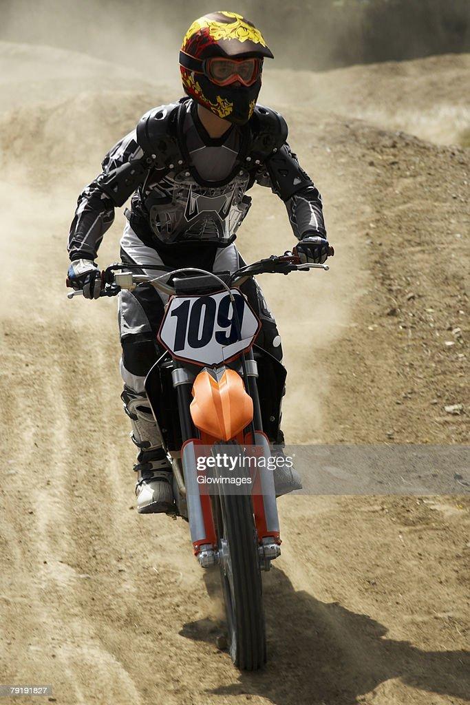 Motocross rider riding a motorcycle : Foto de stock