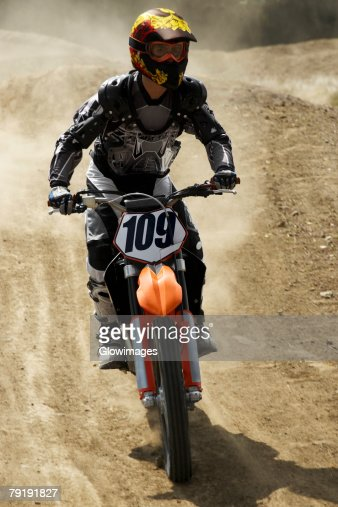 Motocross rider riding a motorcycle : Foto de stock