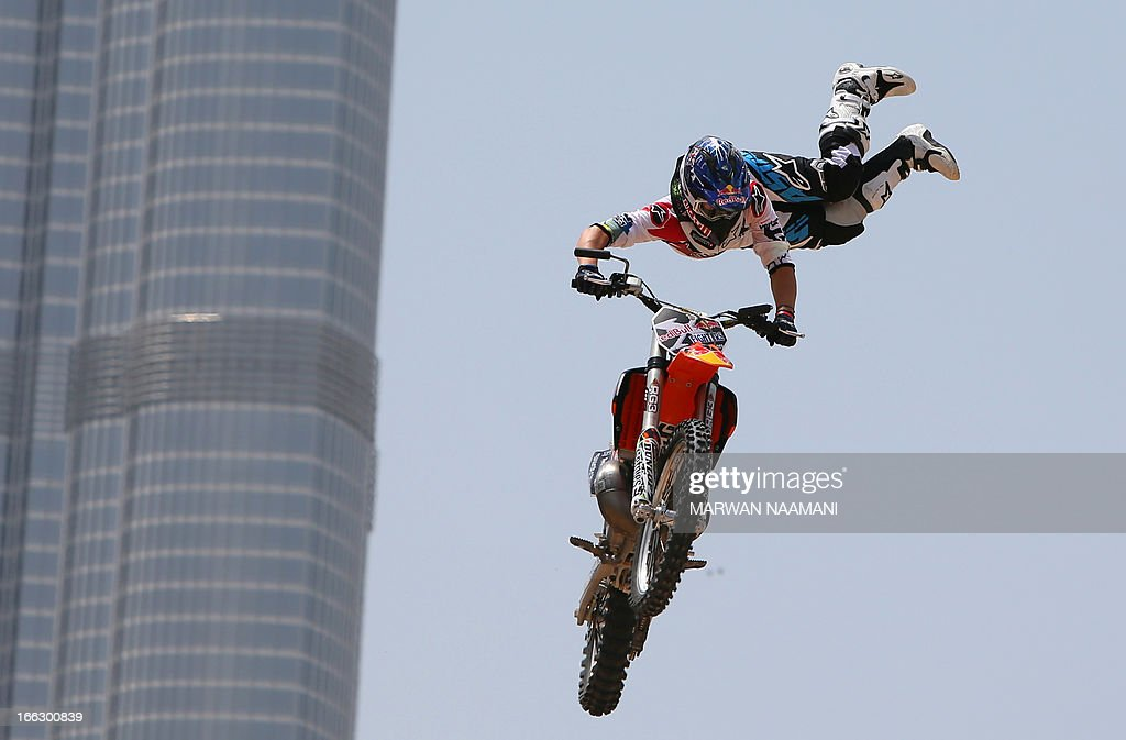 A motocross rider shows his skills during a training session outside Burj Khalifa on the eve of the 2013 Red Bull X-Fighters World Tour in the Gulf emirate of Dubai on April 11, 2013.