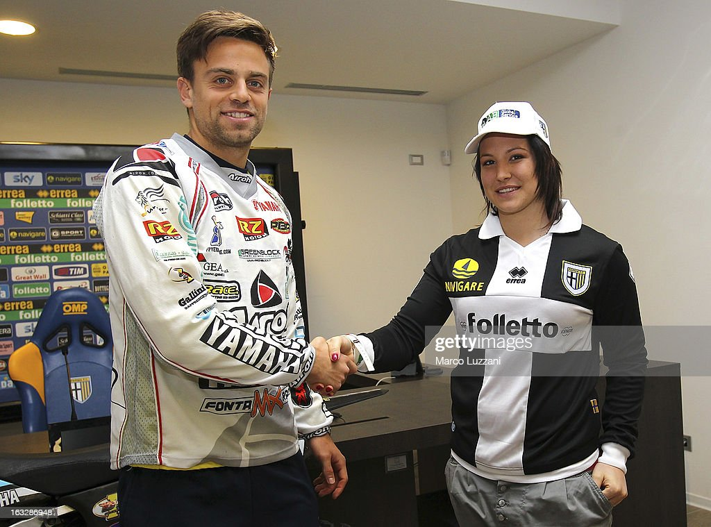 Motocross World Champion Kiara Fontanesi (R) and Daniele Galloppa (L) during a visit at the club's training ground on March 6, 2013 in Collecchio, Italy.