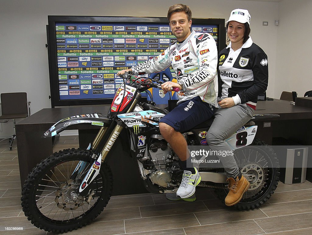 Motocross World Champion Kiara Fontanesi (R) and <a gi-track='captionPersonalityLinkClicked' href=/galleries/search?phrase=Daniele+Galloppa&family=editorial&specificpeople=2333506 ng-click='$event.stopPropagation()'>Daniele Galloppa</a> (L) during a visit at the club's training ground on March 6, 2013 in Collecchio, Italy.