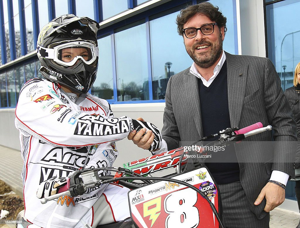 Motocross World Champion Kiara Fontanesi (L) and General Manager of Parma FC Pietro Leonardi (R) during a visit at the club's training ground on March 6, 2013 in Collecchio, Italy.