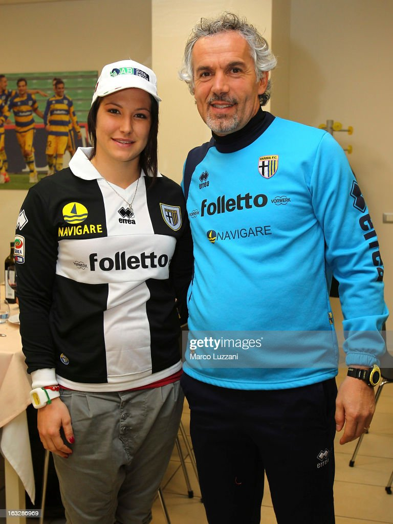 Motocross World Champion Kiara Fontanesi (L) and Parma FC manager Roberto Donadoni (R) during a visit at the club's training ground on March 6, 2013 in Collecchio, Italy.