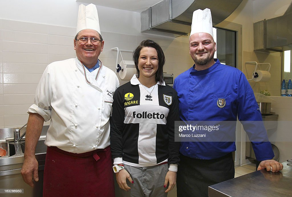 Motocross World Champion Kiara Fontanesi (C), Parma FC chef Ferruccio Minuz (L) and assistant chef Simone Marcolin (R) during a visit at the club's training ground on March 6, 2013 in Collecchio, Italy.
