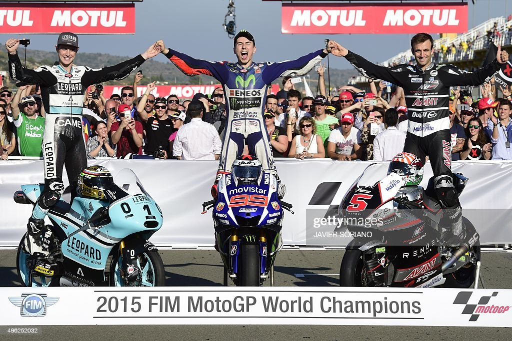 MotoGP Champions, Movistar Yamaha's Spanish rider <a gi-track='captionPersonalityLinkClicked' href=/galleries/search?phrase=Jorge+Lorenzo&family=editorial&specificpeople=543869 ng-click='$event.stopPropagation()'>Jorge Lorenzo</a> (C), Ajo Motorsport's French rider Johann Zarco (R) and Kiefer Racing's British rider Danny Kent pose after the MotoGP motorcycling race at the Valencia Grand Prix at Ricardo Tormo racetrack in Cheste, near Valencia on November 8, 2015.